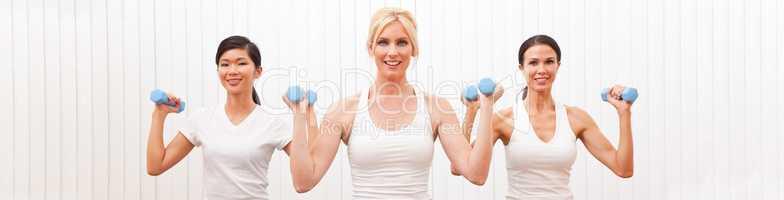 Panoramic Group of Three Women Weight Training Pilates