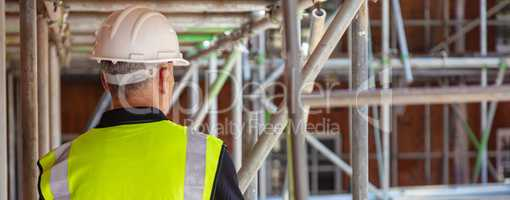Rear View of a Construction Worker on Building Site