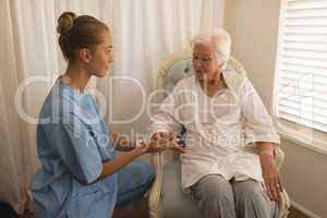 Female physician consoling senior woman