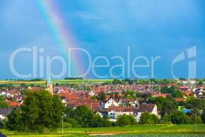 idyllic village with rainbow
