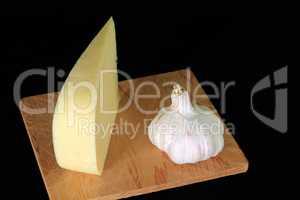 Wedge Smocked Gouda Cheese and Organically grown bulb of Garlic