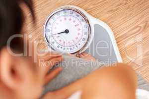 Healthy Female Woman Weighing Herself on Scales