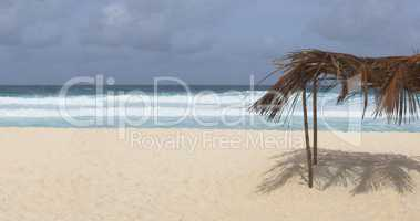 Beach at La Dique island with sun protection, Seychelles