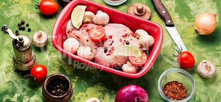 Raw chicken in baking dish