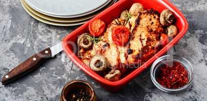Delicious chicken in baking dish