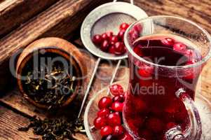 Berry tea on wooden table
