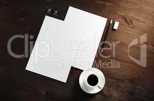 Letterheads, coffee cup, pencil, eraser