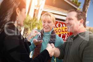 Hispanic Female Real Estate Agent Handing Over New House Keys