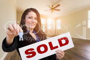 Hispanic Woman With House Keys and Sold Real Estate Sign