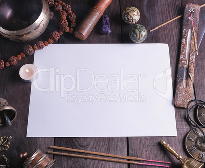 blank white sheet in the middle of religious objects for meditat