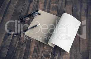 Booklet, glasses, pencil