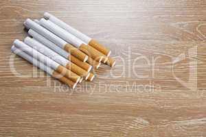 Cigarettes on a wooden background