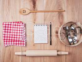 blank open notebook in line and wooden kitchen accessories, reci