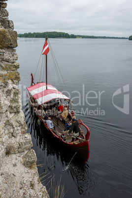 Boat at Koknese castle ruins.