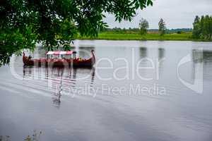 Old wooden viking boat in river