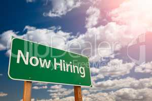 Now Hiring Green Road Sign Aginst Sky