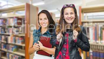 Mixed Race Female Students with Backpack and Books at Library