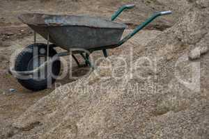 Wheelbarrow for construction in site building area.