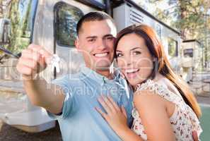Young Military Couple Holding In Front of New RV