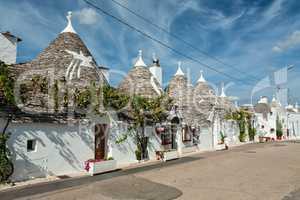 Trulli houses in the shopping street in Alberobello, Puglia, Ita