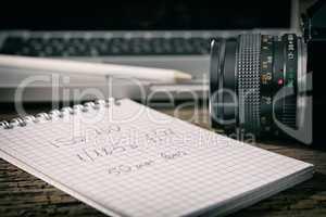Closeup of a camera and a written notebook