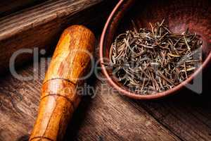Dried rosemary on wooden background