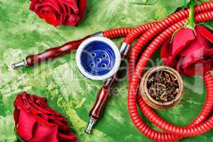 Smoking hookah with rose flavor