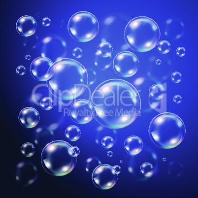 Transparent bubbles over dark blue