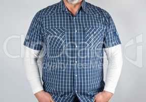 torso of a man in a blue checked shirt