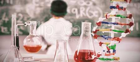 Chemicals beaker and flasks n table in laboratory