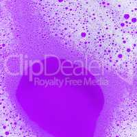 Soap sud on purple