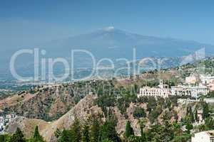 View of a part of Taormina city and the Etna volcano, Sicily, It