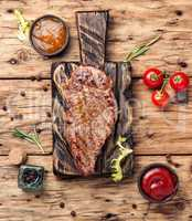 Beef steak on a wooden background