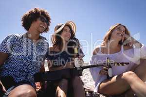 Happy group of friends having fun at beach in the sunshine