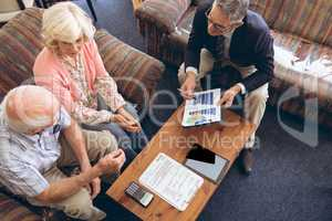 Physician showing medical statistics to senior couple