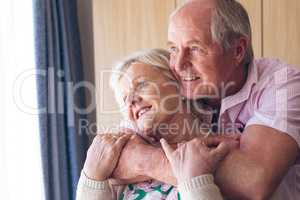 Couple posing while standing  at retirement home