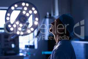 Nervous male surgeon sitting in operation room at hospital