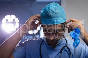 Male surgeon getting ready for the operation