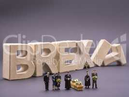 Miniatur people funeral with BREXIT letters in the backround