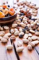 Mix of dried fruits and nuts in backlit