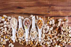 Mix of nuts over a rustic table
