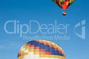 Colorful hot-air balloon ready to get up in flight and another a