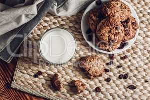 Glass of Milk and Oatmeal Cookies on White Plate