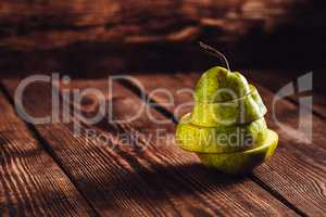 Sliced Pear on Wooden Background.