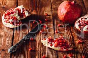 Opened Pomegranate Fruit and Knife