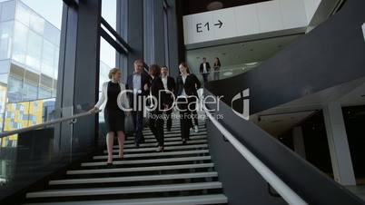 Business people at hall of office building