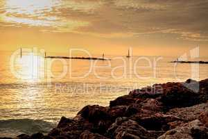 Sailboat against the golden sky of South Marco Island Beach at S