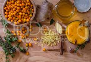 ingredients for cocktail recipe with sea buckthorn and honey