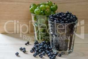 Blueberries and gooseberries in glass