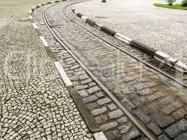 Urban tram track in cobbled street.